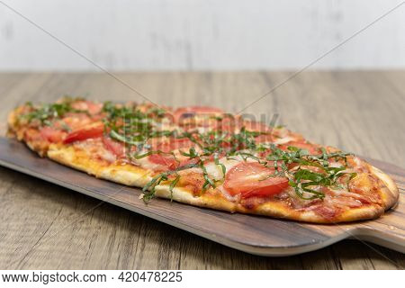 Margarita Flatbread Pizza Topped With Slices Of Tomato, Cheese On Delicious Baked Flatbread Crust.