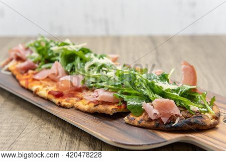 Delicious Arugula Prosciutto Flatbread Looks A Lot Like Pizza But With Long Shaped Crust.