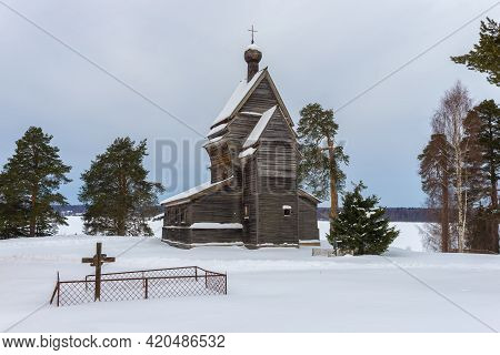View Of The Old Wooden Church Of St. George The Victorious (1522) On A Gloomy February Day. Rodionov