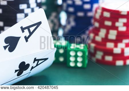Poker ace pair on chips and dice background