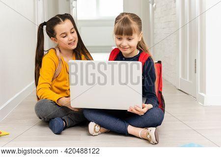 Distance Learning Online Education. Schoolgirls With Laptop Notebook Doing School Homework. Two Scho