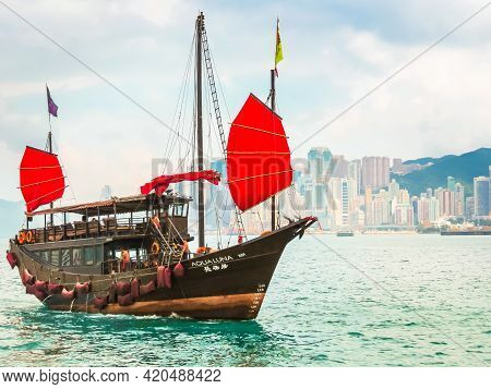 Hong Kong, Hong Kong - November 09, 2012: Traditional Wooden Sailboat Or Junk Boat With Red Sails In