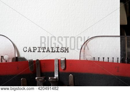The word capitalism  written with a typewriter.