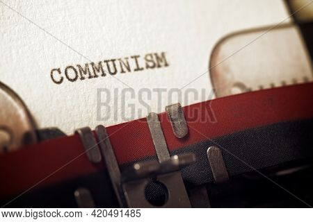 The word communism written with a typewriter.