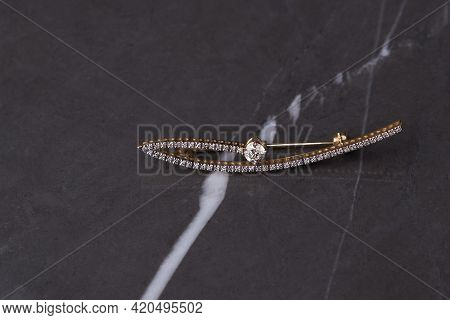 Diamond Brooch On Pastel Silk Background, Close-up.