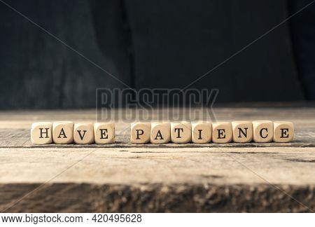 Small Wooden Blocks With The Words Have Patience