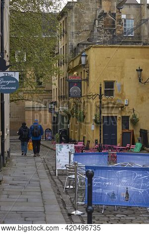 Bath, England - April 29, 2021: Tables And Chairs Set Up Outside Cafes, Restaurants And Bars In The
