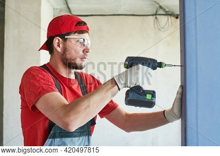 Gypsum plasterboard work. Drywall construction at home. Contractor worker installing wall