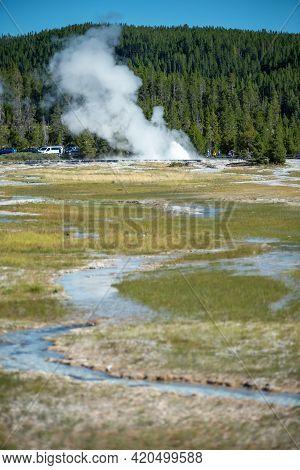 Eruption Of Old Faithful Geyser At Yellowstone Nationl Park