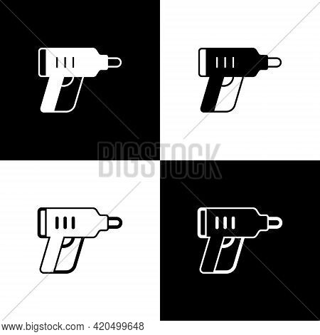 Set Electric Cordless Screwdriver Icon Isolated On Black And White Background. Electric Drill Machin