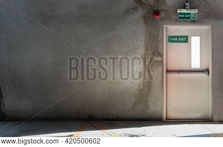 Fire Exit Door For Emergency Case With Alarm For Safety Protection Of The Car Parking Building. Safe