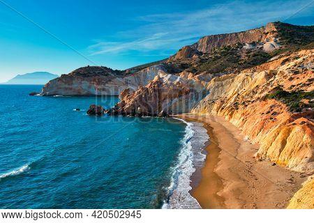 Agios Ioannis greek beach and Aegean sea on sunset. Milos island, Greece