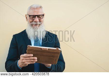 Senior Business Man Working On Digital Tablet Outdoor - Entrepreneurship And Technology Concept
