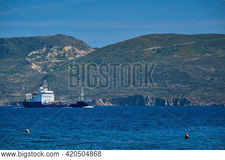 Cargo ship in the Aegean sea, Milos island, Greece