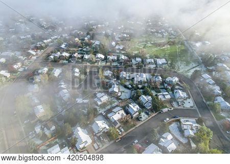 foggy spring morning over residential area of Fort Collins in northern Colorado after heavy rain and snow, aerial view