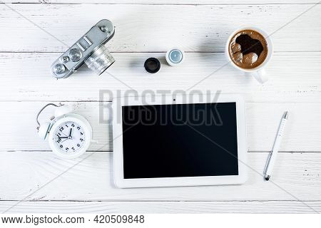 Tablet And Rangefinder Film Camera Photography Setting, With A Cup Of Coffee And Alarm Clock On A Wo