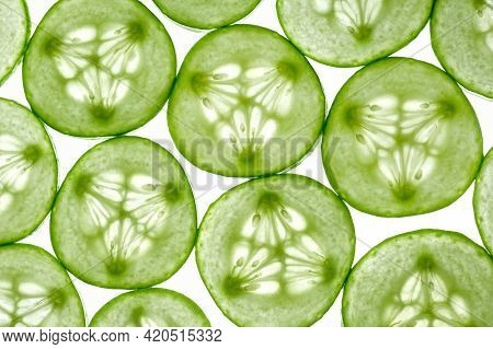 Fresh Sliced Cucumber Slices Isolated On A White Background. Cucumber Slices In Light. Top View