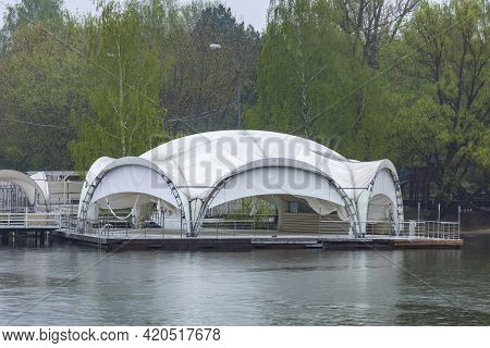 A Gazebo Made Of White Tarpaulin On The Banks Of The River For Tourists