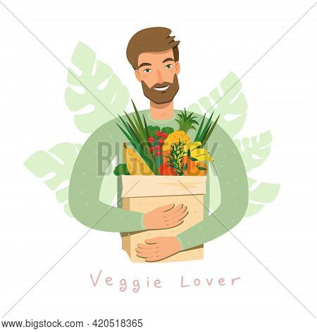 Young Man Holding Natural Fruits And Vegetables In Grocery Paper Bag. Bearded Vegan Man Eat Organic