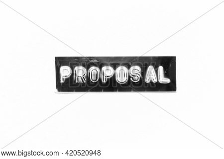 Embossed Letter With Word Proposal In Black Banner On White Paper Background