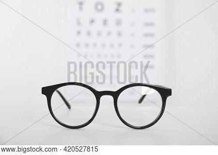 Glasses On Light Background, Closeup. Ophthalmologist Prescription