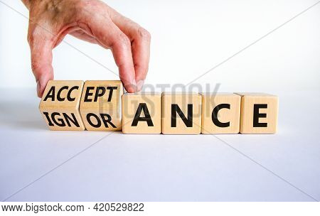 Acceptance Or Ignorance Symbol. Businessman Turns Cubes, Changes The Word 'ignorance' To 'acceptance