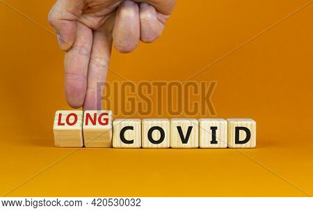 Long Covid Symbol. Doctor Turnes Wooden Cubes And Changes Words 'covid' To 'long Covid'. Beautiful O