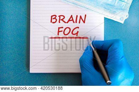 Medical, Covid-19 Pandemic Coronavirus Brain Fog Symbol. Doctor Hand. White Note With Words 'brain F