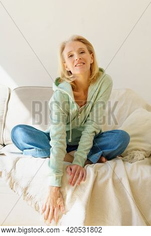Enjoying Retired Life. Portrait Of Happy Pleasant Mature 60s Woman In Casual Wear Resting On Coach A