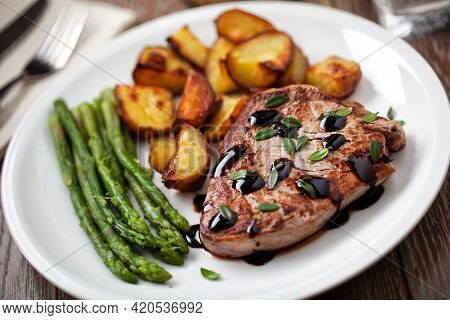 Fillet Of Beef With Potatoes And Asparagus On A Plate.