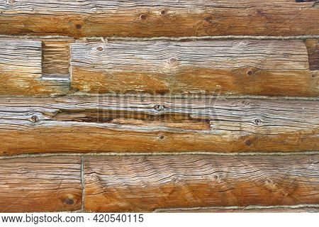 Log Masonry From Thick Old Cracked Logs, Wood Structure, Cracks And Knots, Background