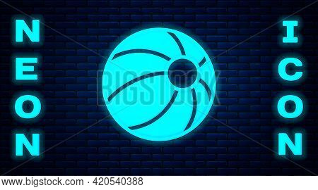 Glowing Neon Beach Ball Icon Isolated On Brick Wall Background. Children Toy. Vector