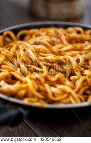 Handmade Tagliatelle Pasta With Tomato Sauce, Pesto And Cheese