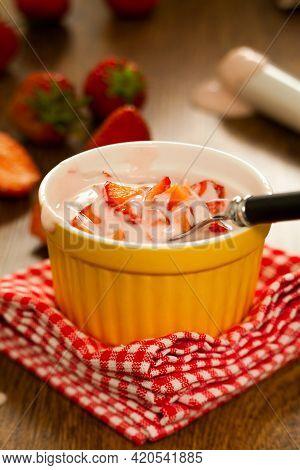 Strawberry Yogurt On A Plate. High Quality Photo.