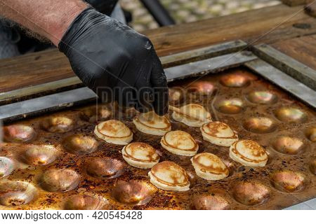 Close Up View  Of A Male Baker Preparing Fresh The Sweet Dutch Batter Treat Called Poffertjes On A S