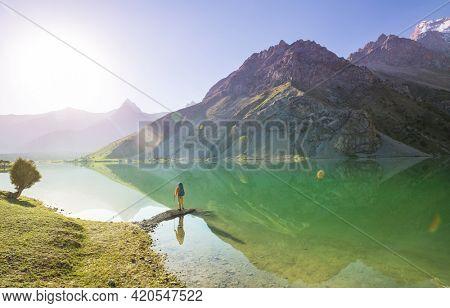 Beautiful serene lake in  Fanns mountains (branch of Pamir) in Tajikistan.