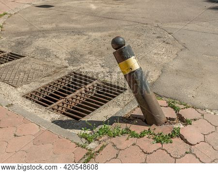 Storm Drain And Restrictive Displaced Pole. Offset Restraining Post.
