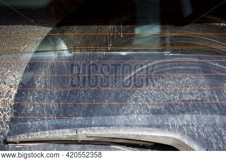 Rear Window Of A Dirty Car With A Windshield Wiper Covered With A Layer Of Dry Dust Rear View Of A V