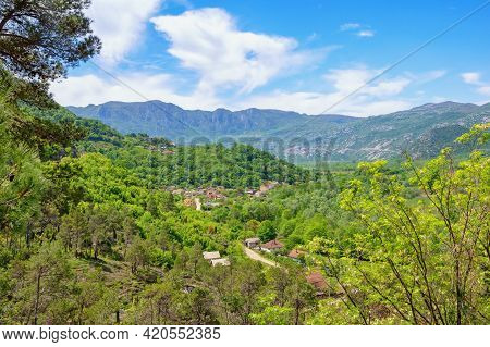 Beautiful Mountain Landscape With Small Village On Sunny Spring Day.  Montenegro. National Park Lake