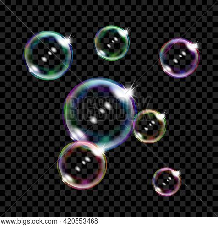 Set Of Several Translucent Colored Soap Bubbles On Transparent Background. Transparency Only In Vect