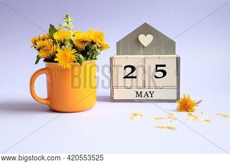 Calendar For May 25: Cubes With The Number 25, The Name Of The Month Of May In English, A Bouquet Of