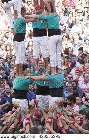 Tarragona, Spain, September 19, 2019 - Human Tower Basis Vilafranca Castellers. Tourist Crowds At Tr