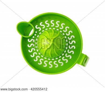 Green Manual Citrus Juicer With Handle Isolated On White Background. Modern Plastic Citrus Press For