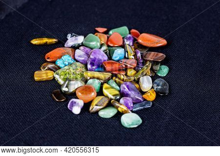 Different Colorful Gemstones On Dark Background. Stone Therapy, Spiritual Healing, Crystal Energy, L