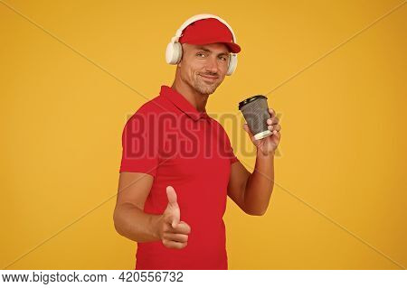 Where Music Lives And Coffee Rocks. Modern Guy Drink Coffee Listening To Music. Handsome Man Point F