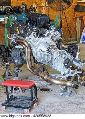 Car Engine And Transmission Standing N Floor In Shop