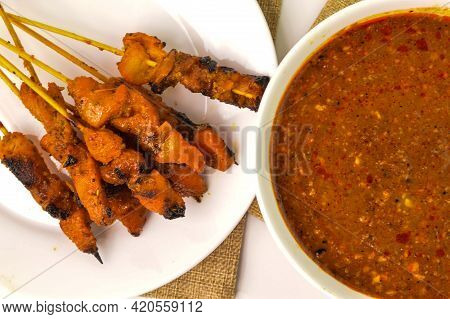 Malaysian Chicken Satay With Delicious Peanut Sauce, One Of Famous Local Dishes Especially During Ei