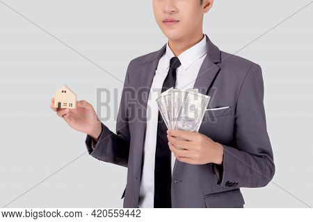 Young Asian Business Man Holding Home And Money Dollar For Saving For Future, Insurance Agent And Cr