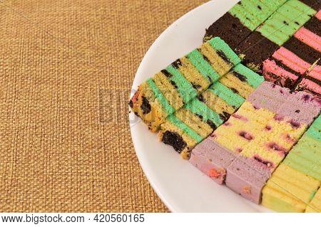 Malaysian Traditional Food Called As Kek Lapis Sarawak Or Sarawak Layered Cake On White Plate. Simil