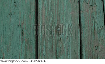 Background Of Green Flaky Wood. Backdrop Of Green Colored Wooden Panels With Aged Flaky Surface.